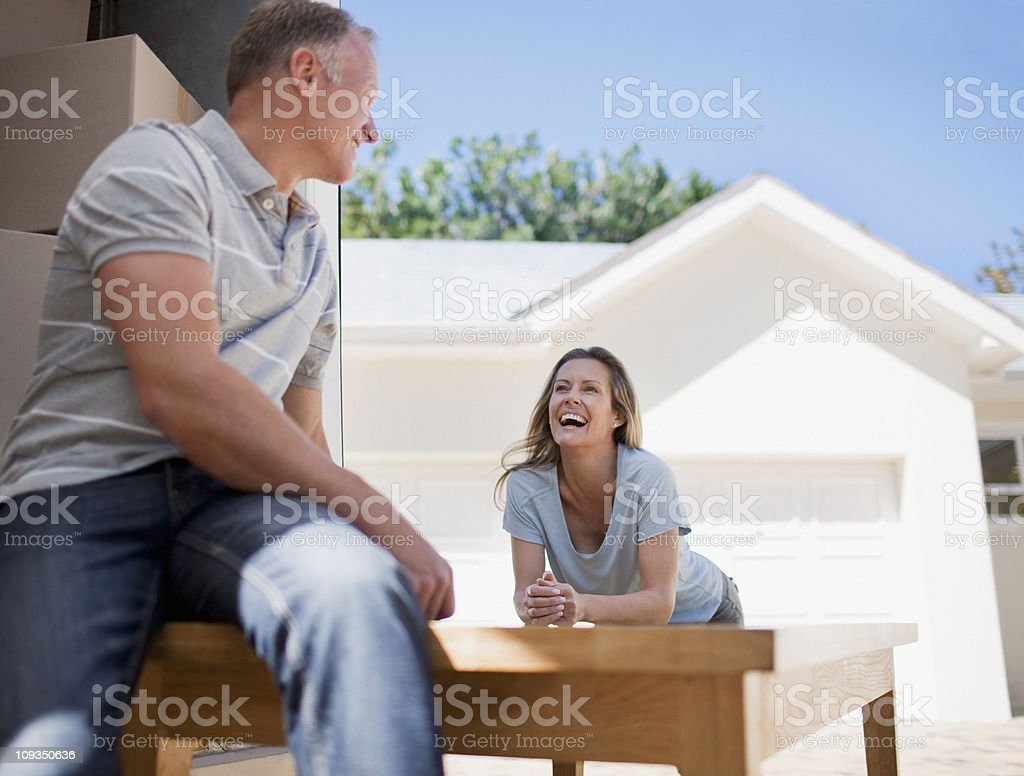 Couple moving table into new house royalty-free stock photo