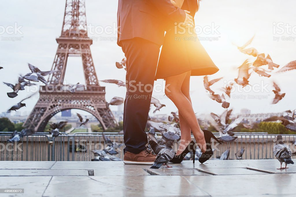 couple near Eiffel tower in Paris stock photo