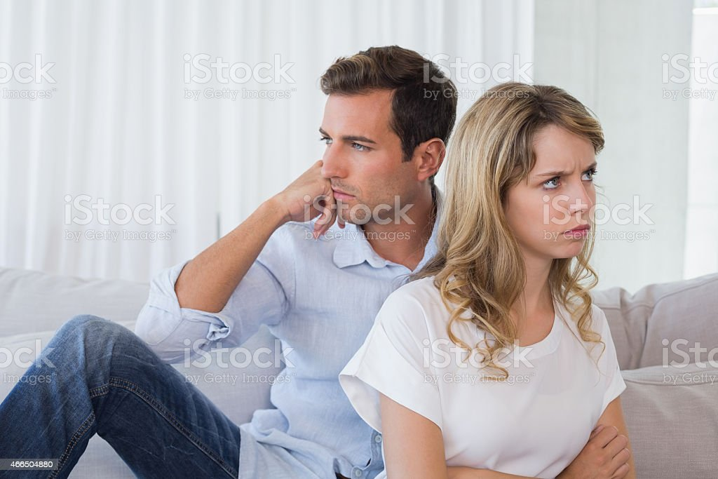 Couple not talking after an argument in living room stock photo