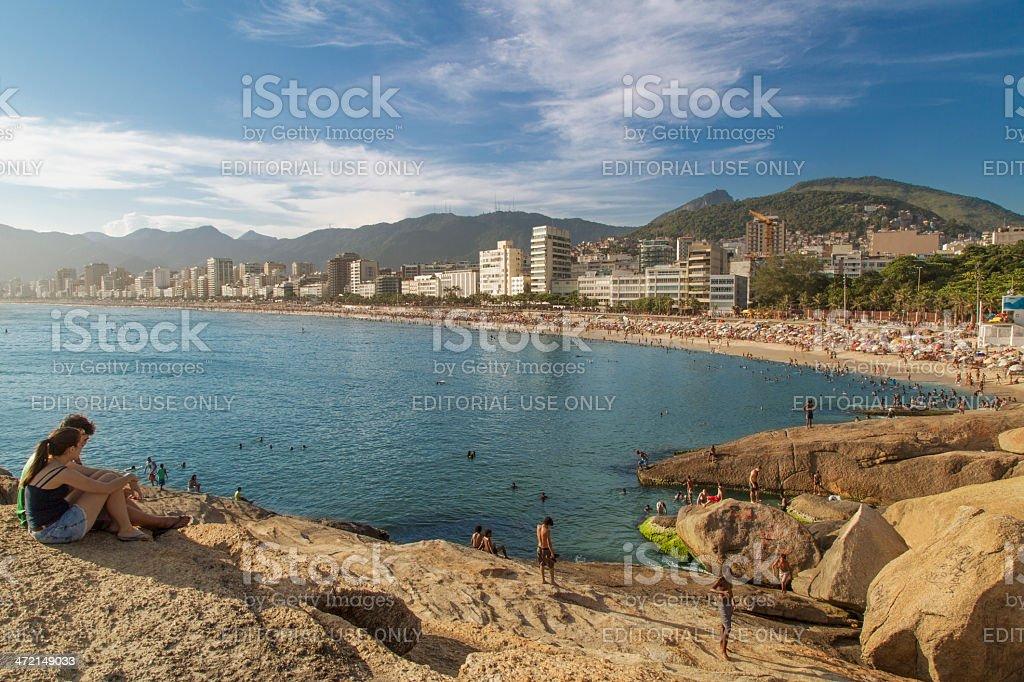 Couple observes the beaches from Arpoador Stone stock photo