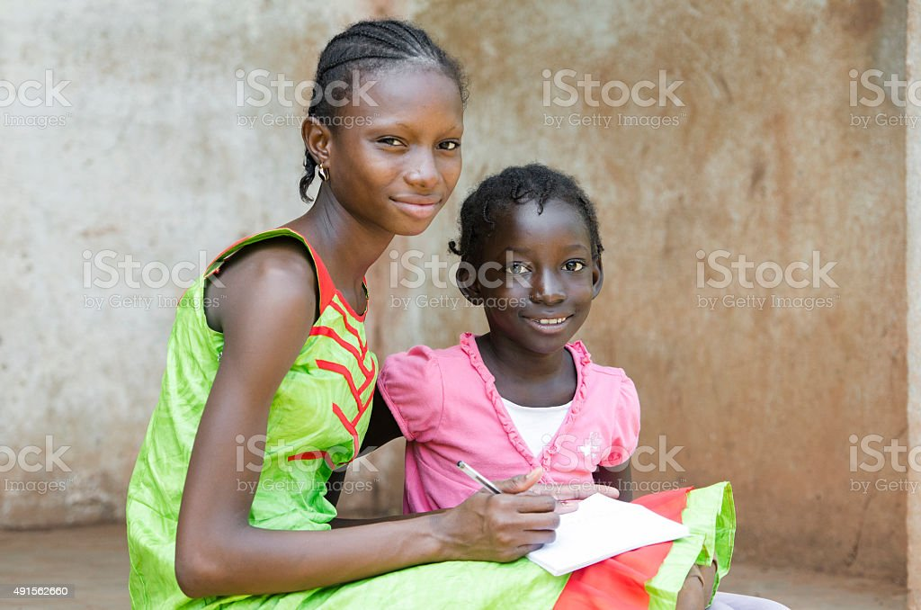 Couple of African Girls Learning Symbol (Education for African Children) stock photo