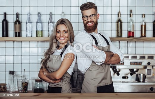 istock Couple of barista in coffee shop 921287288