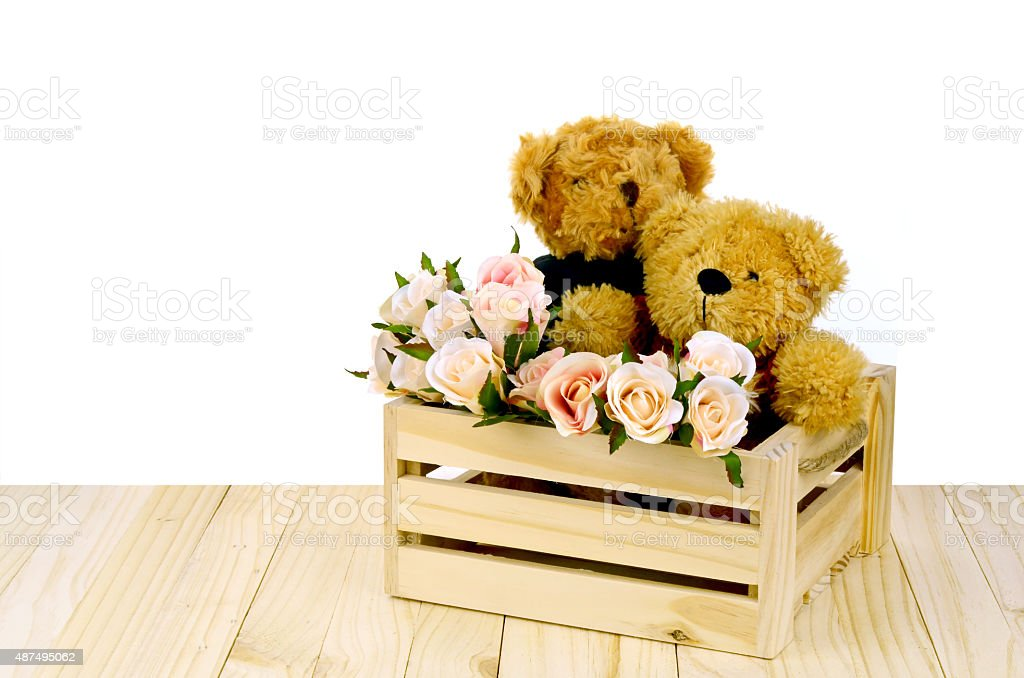 Couple of Bear and Pink Roses in Pine Wood Box. stock photo