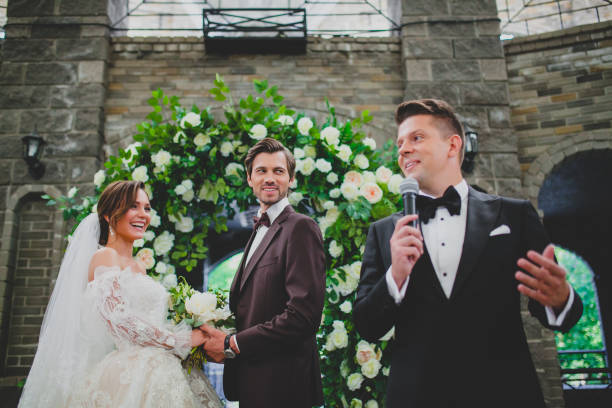 Couple of beautiful and elegant newlyweds on wedding ceremony stock photo