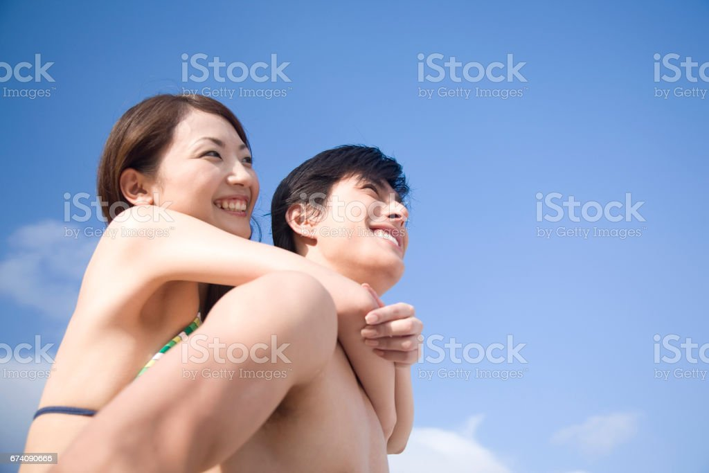 A couple of blue sky and a swimsuit royalty-free stock photo