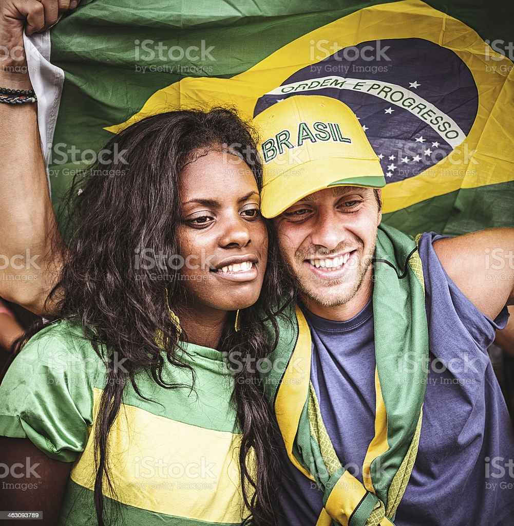 Couple of brazilian loves supporters at stadium stock photo