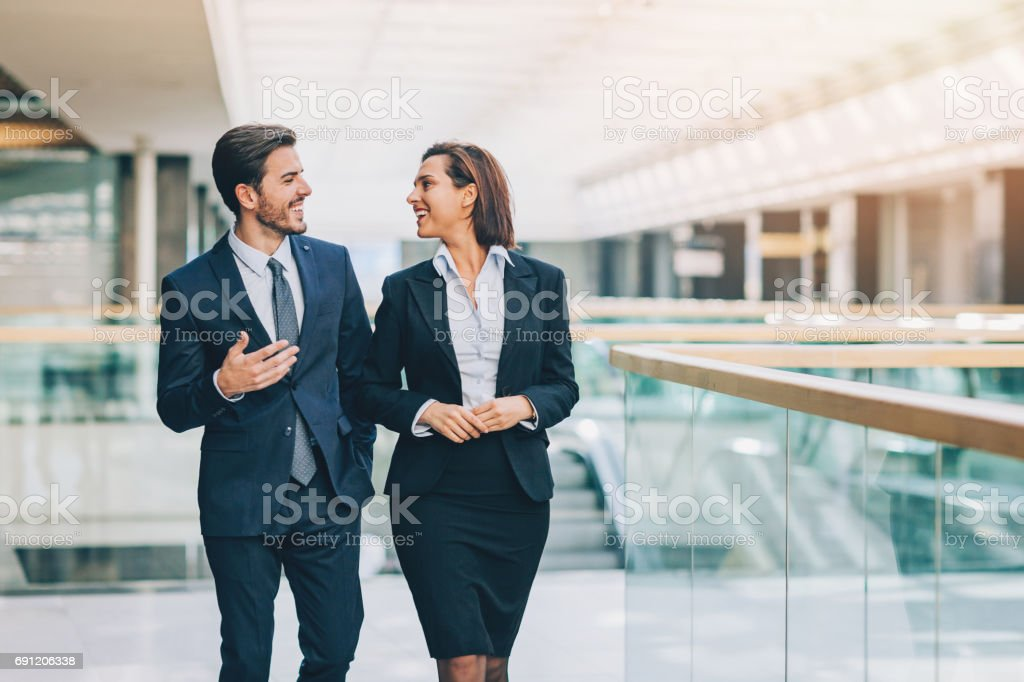 Couple of business persons in friendly discussion stock photo