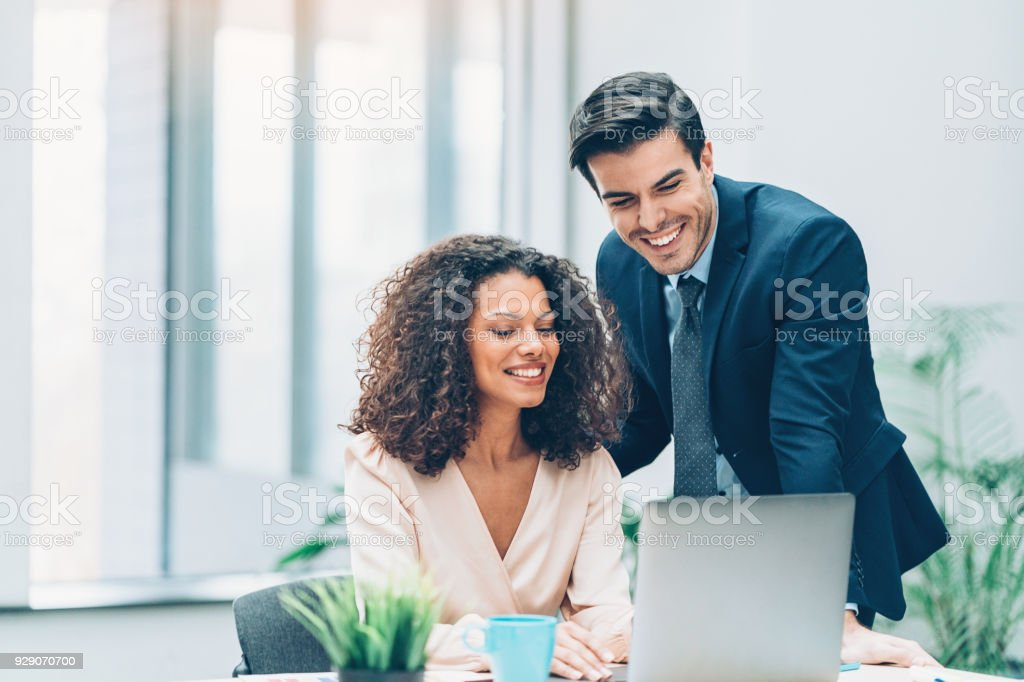 Couple of business persons in the office stock photo