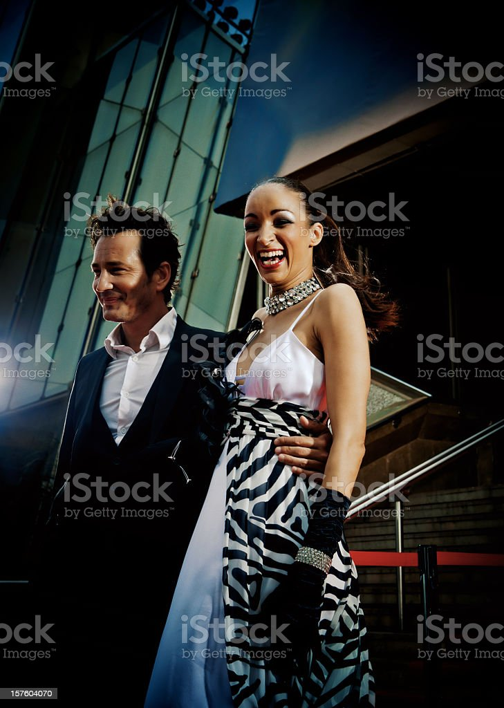couple of celebrities in the red carpet stock photo