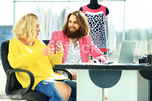 istock couple of copywriters discussing new ideas in a modern Studio 1003146210