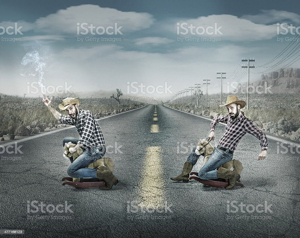 couple of cow boys riding horses stock photo