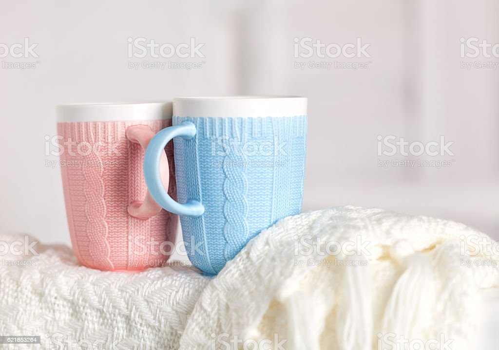 Couple of cups with knitting pattern, pink and blue color stock photo