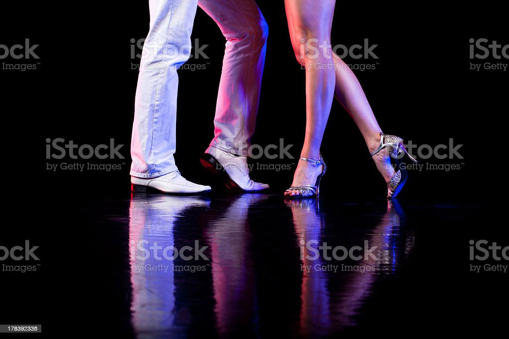 Couple of dancers during a routine on the dance floor stock photo