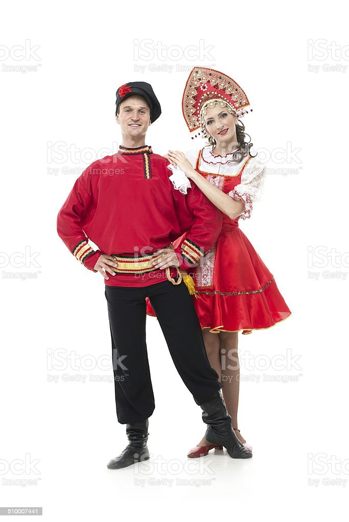 Couple of dancers in russian traditional costumes stock photo