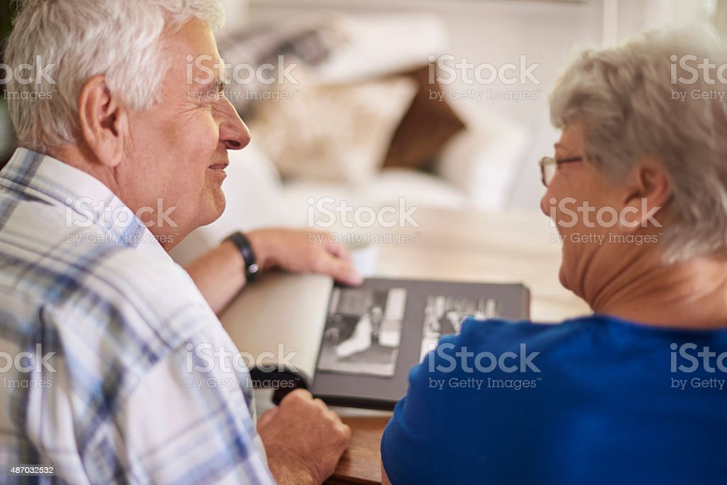 Couple of elder couple reminiscing their past stock photo