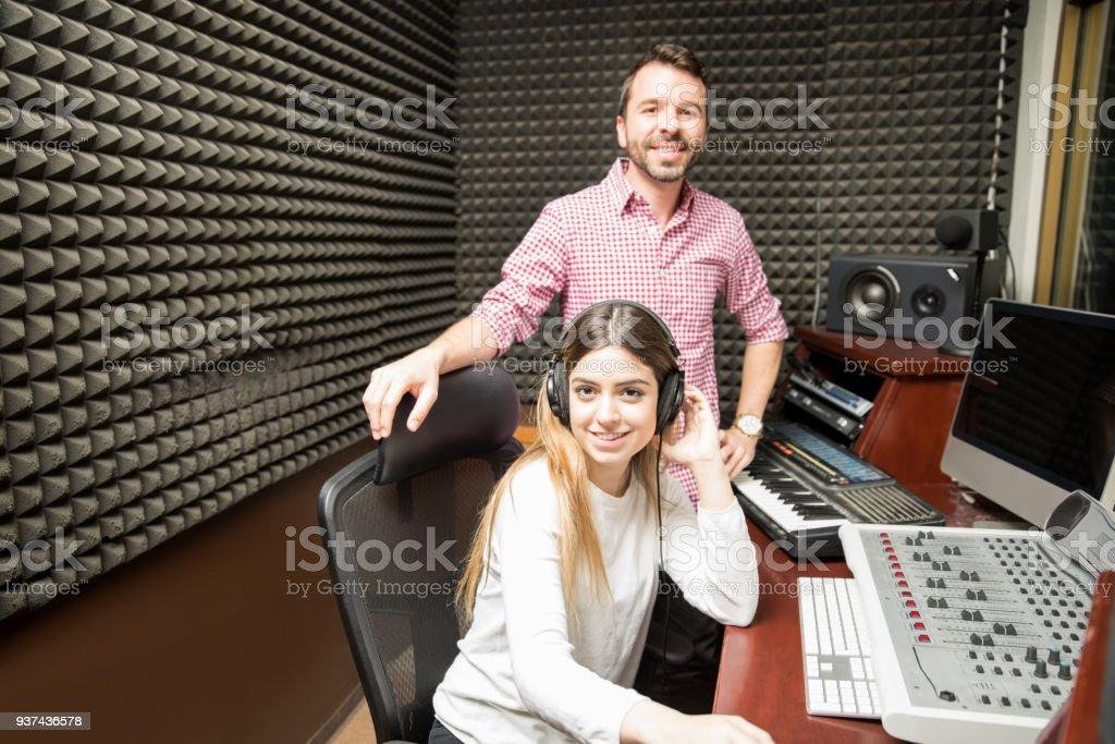 Couple of experienced sound engineers in recording studio stock photo