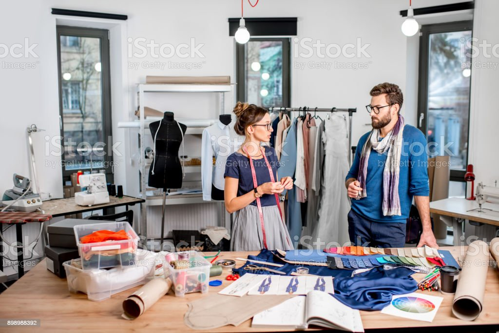 Couple Of Fashion Designers Working At The Studio Stock Photo Download Image Now Istock
