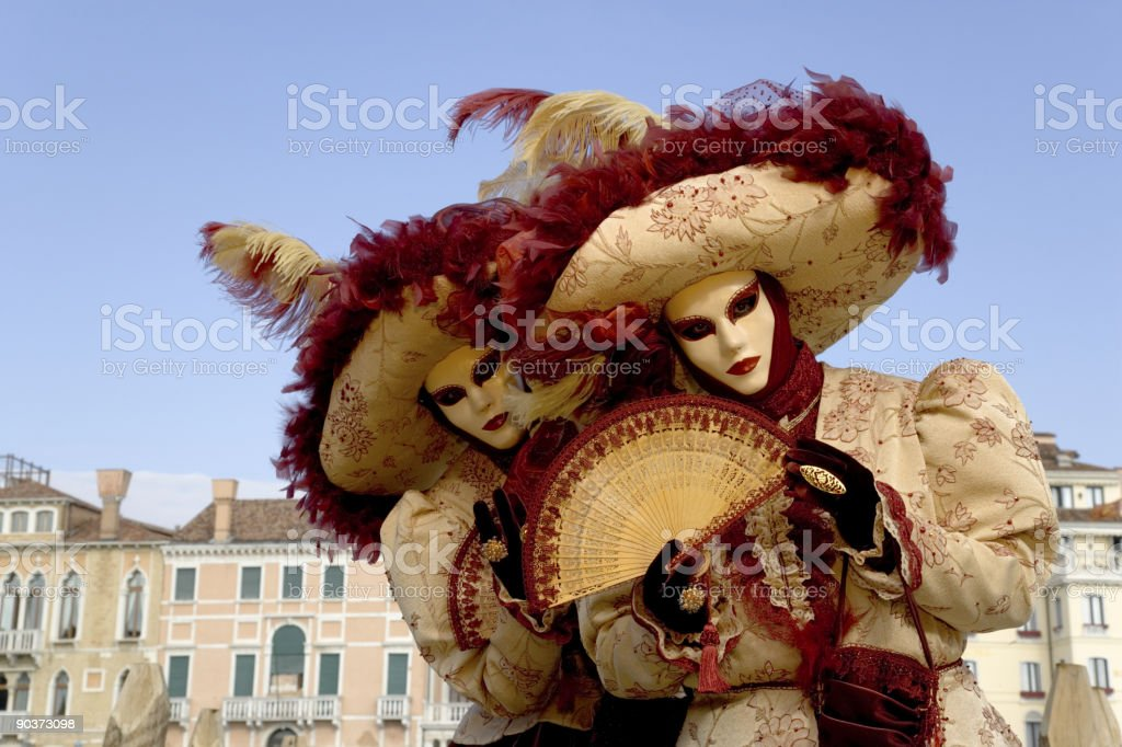 Couple of female masks with beautiful costumes in Venice (XXL) royalty-free stock photo