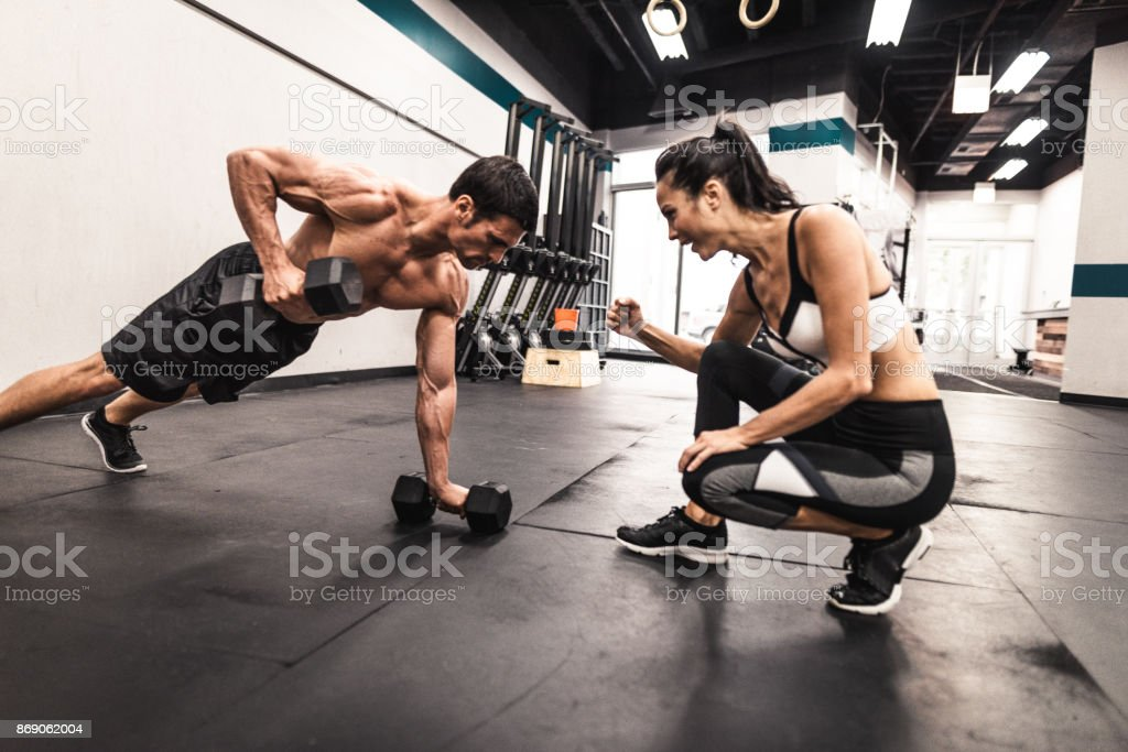 couple of fitness models doing the pushups stock photo