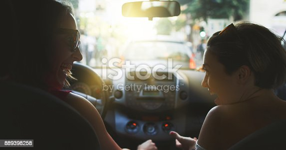 907987862 istock photo Couple of friends in a car: the traffic of Rome 889398258