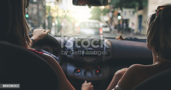 907987862 istock photo Couple of friends in a car: the traffic of Rome 889398302