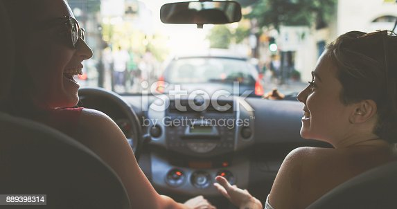 907987862 istock photo Couple of friends in a car: the traffic of Rome 889398314
