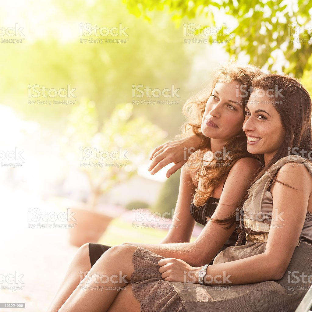 couple of friends smiling outdoors royalty-free stock photo
