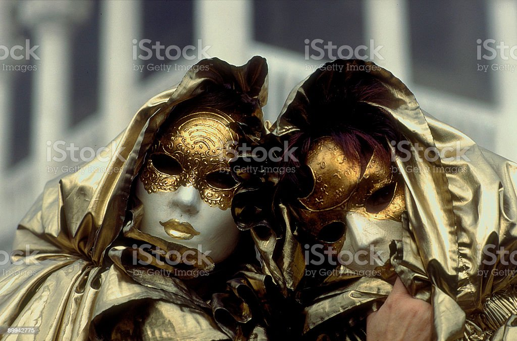 Couple of golden masks at carnival in Venice royalty-free stock photo