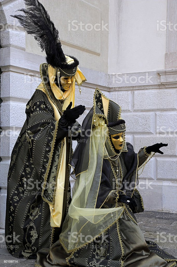 Couple of golden masks at carnival in Venice (XXL) royalty-free stock photo