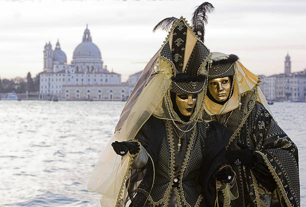 Couple of golden Venetian masks at Grand Canal (XL) stock photo
