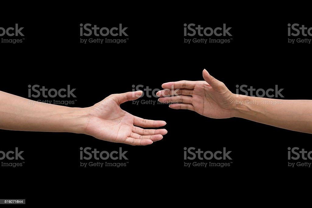 couple of helping/praying hand black background stock photo