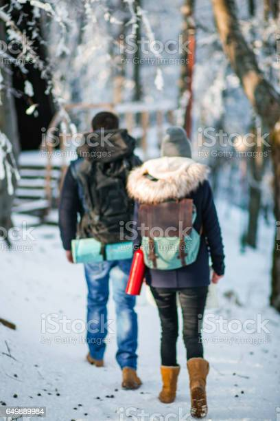 Photo of Couple of hikers in mountain forest