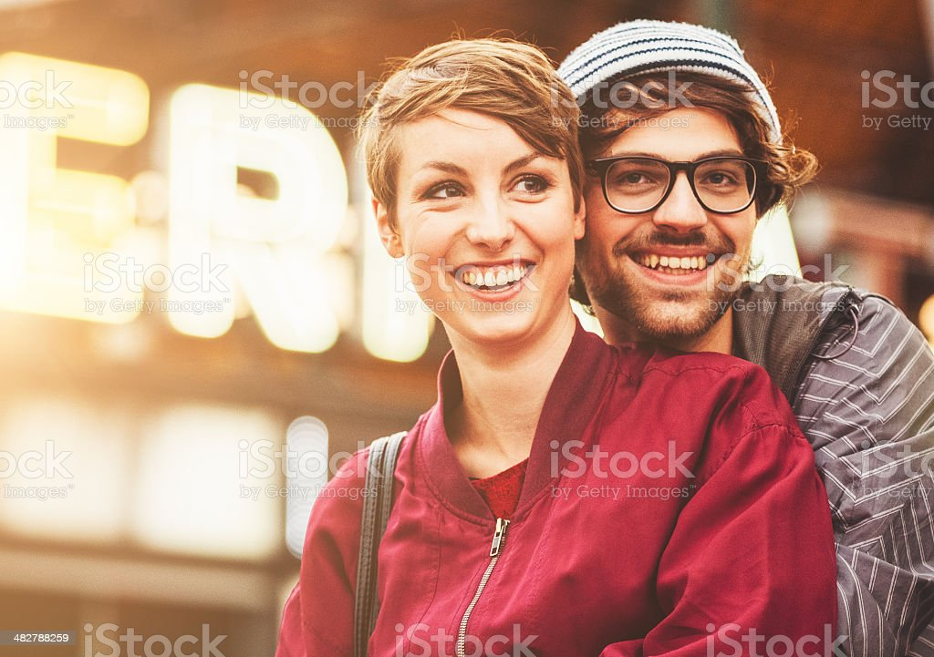 couple of hipsters embraced on alexanderplatz stock photo