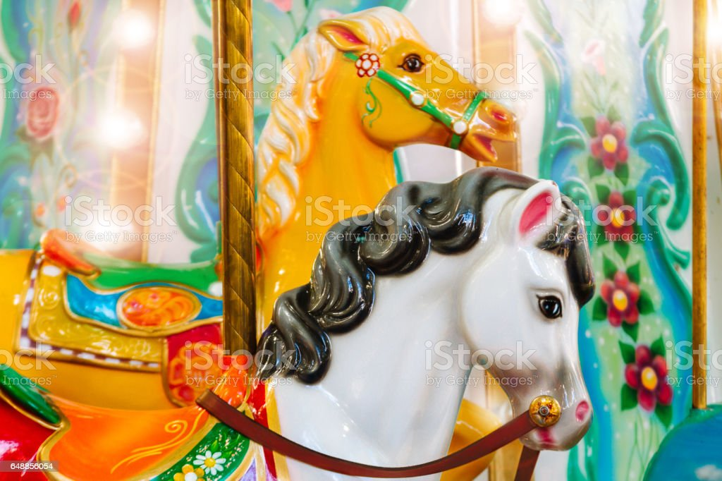 Couple of horse of merry-go-round with lights and flare stock photo