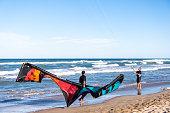Valencia, Spain; 27 september 2020: A couple of kitesurfers practice kitesurfing in the Mareny de San Lorenzo beach