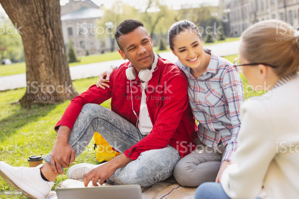 Couple of lovely students spending time together royalty-free stock photo