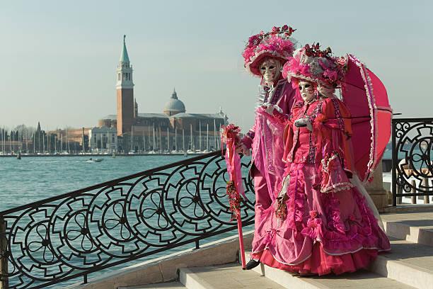 Couple of masks on bridge at carnival in Venice (XXXL) stock photo