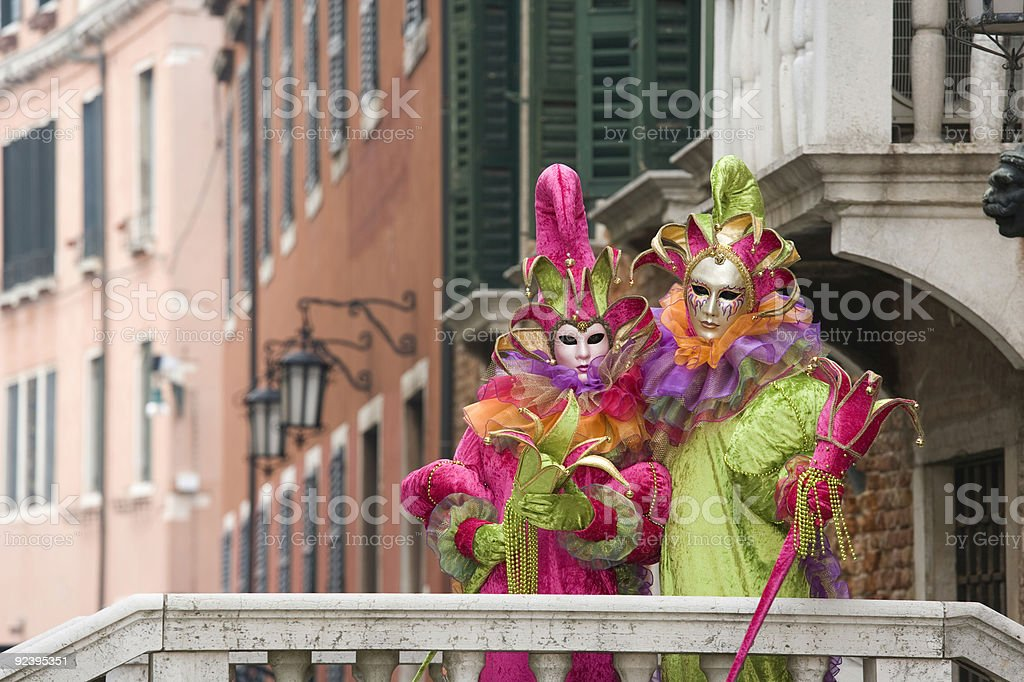 Couple of masks with beautiful costumes at carnival in Venice royalty-free stock photo