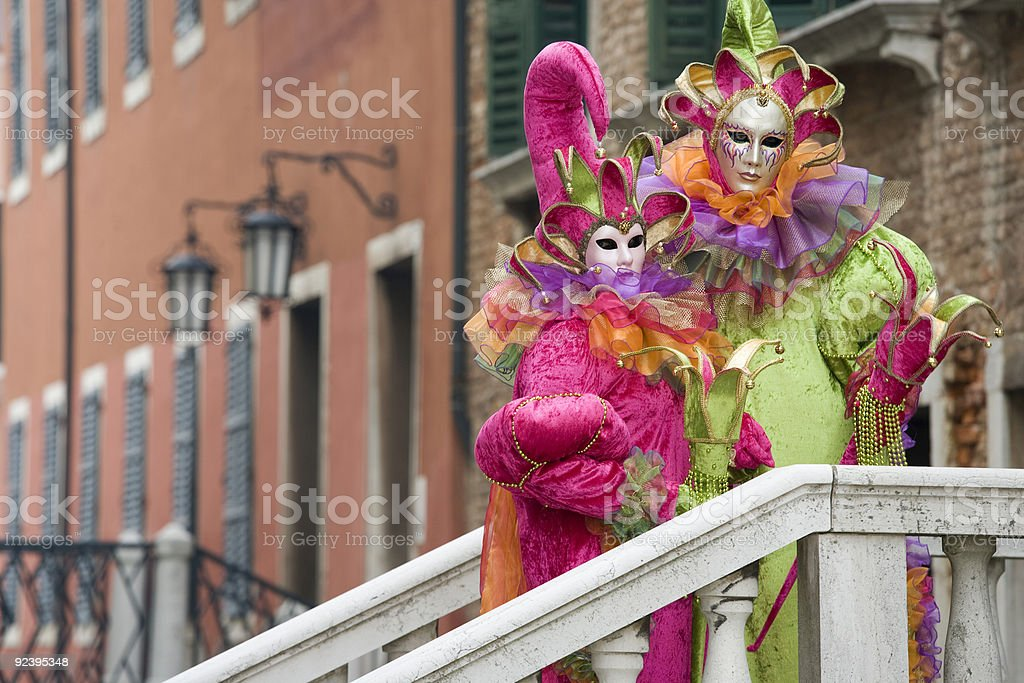 Couple of masks with jester costumes at Carnival in Venice royalty-free stock photo