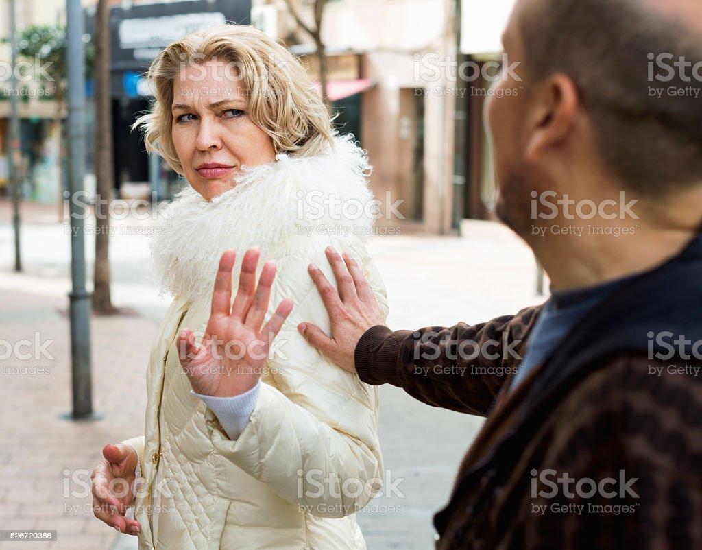 Couple of pesioners having quarrel stock photo