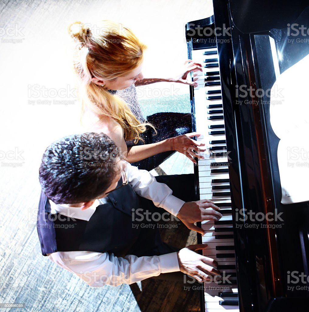 Couple of pianists playing. stock photo