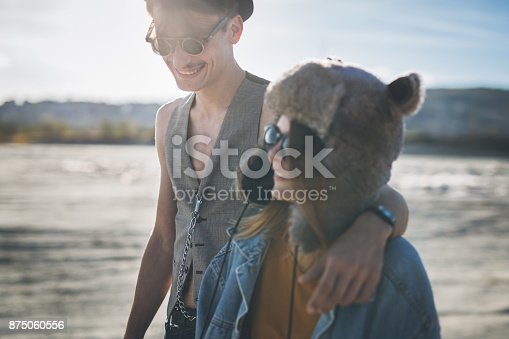 Young couple of rebellious skateboarders having fun on the wasteland