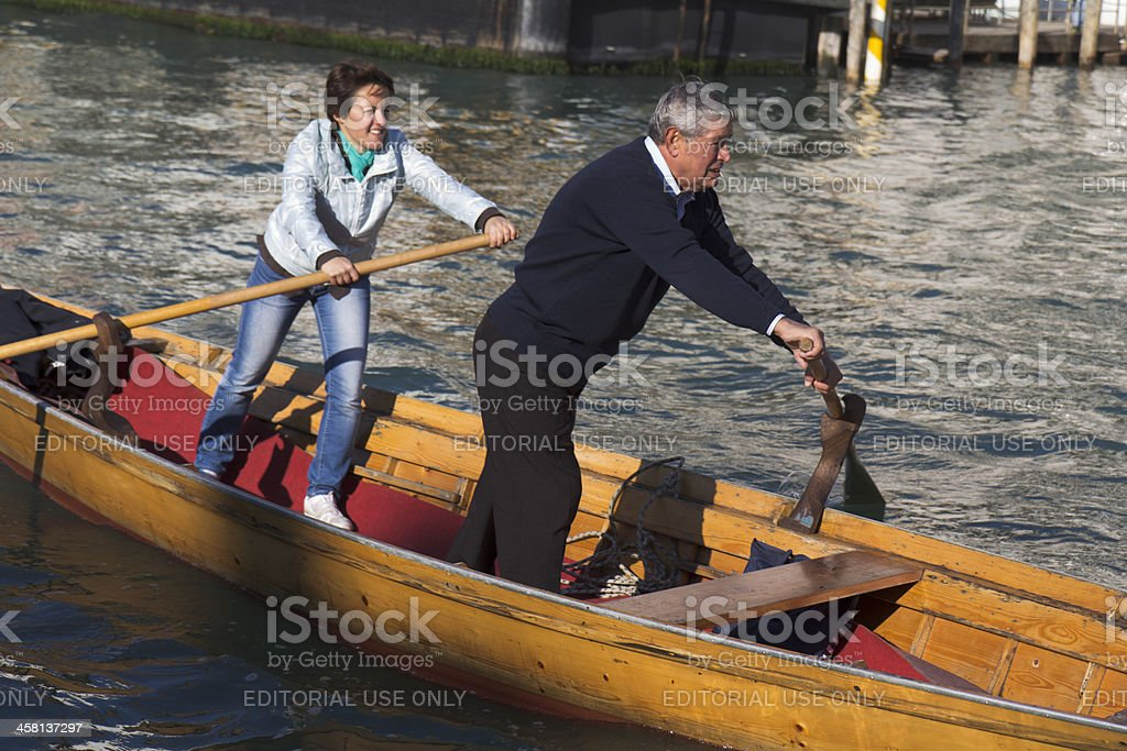 Couple of rowers standing in their boat. royalty-free stock photo