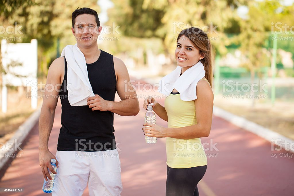 Couple of runners taking a break stock photo