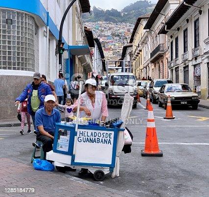 istock Couple of Street Vendors Selling Ice Cream in Quito, Ecuador 1285184779