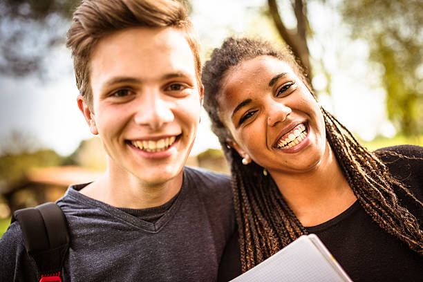 couple of student happiness on the park stock photo