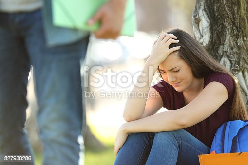istock Couple of students breaking up relationship 827930286