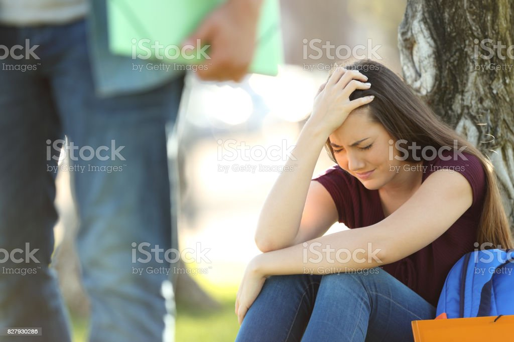 Couple of students breaking up relationship stock photo