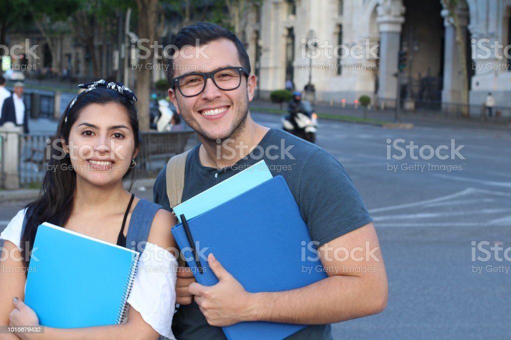 Couple of students on the street stock photo