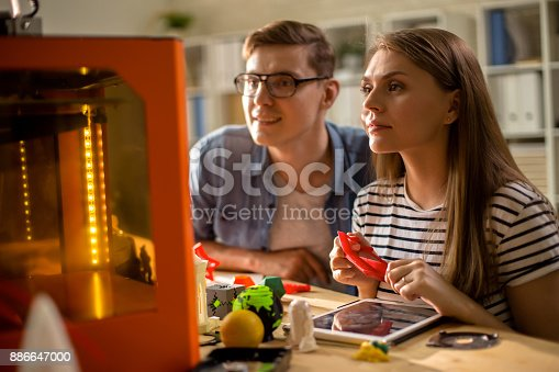 886646936 istock photo Couple of Students Using 3D Printer 886647000